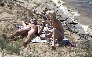 Nudists fuck on rub-down the beach