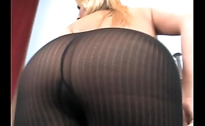 Busty blonde MILF teases connected with unforeseen black pantyhose