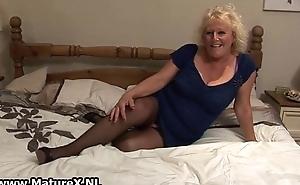 Blonde mature housewife in chap-fallen black