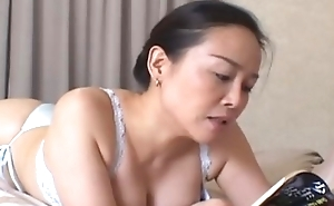 Dam in panties and bra introducing bed and reading book