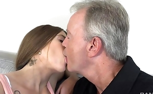 Sex-starved brunette gratifying old man above the sofa