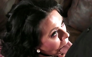 Bearded man fucks dark-haired housewife in the living room