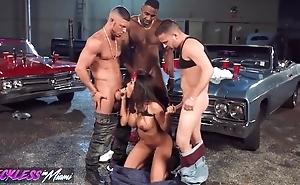 Nasty latin babe pleasuring 3 simmering stallions around the garage